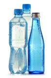 Tre bottiglie di acqua minerale isolate su bianco Immagini Stock Libere da Diritti