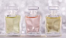 Tre bottiglie di profumo Fotografie Stock Libere da Diritti