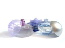 Tre bottiglie di profumo su una priorità bassa bianca Immagini Stock Libere da Diritti