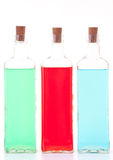 Tre bottiglie di vetro Immagini Stock