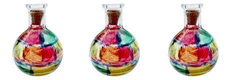 Tre bottiglie di vetro macchiate immagine stock