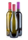 Tre bottiglie di vino isolate su fondo bianco Fotografia Stock Libera da Diritti