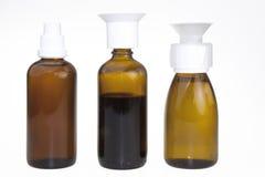 Tre bottiglie mediche del browm Fotografie Stock