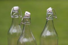 Tre bottiglie per il latte autentiche antiquate Fotografia Stock Libera da Diritti