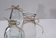 Tre bottiglie vuote di vetro per i fiori Immagine Stock Libera da Diritti