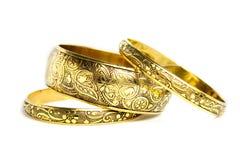 Tre braccialetti dorati Fotografia Stock Libera da Diritti