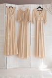 Tre brudtärnors klänningar Royaltyfri Fotografi