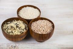 Tre bunkar med olika variationer av ris Arkivbilder