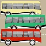 Tre bus che viaggiano sulla strada Immagini Stock Libere da Diritti