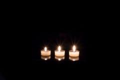 Tre candele ardenti Fotografie Stock Libere da Diritti