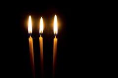 Tre candele gialle della cera Fotografia Stock Libera da Diritti