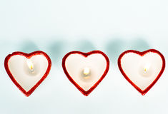 Tre candele heart-shaped Immagini Stock