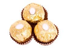 Tre caramelle di cioccolato. Fotografie Stock
