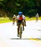Tre cavalieri della bicicletta Fotografia Stock