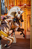 Tre cavalli fatti funzionare sulle rotonde francesi Fotografia Stock