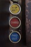 Tre chiavi antiche del registratore di cassa con ricevuto sul conto, sulla tassa e su pagato fuori scritti su loro Immagini Stock Libere da Diritti