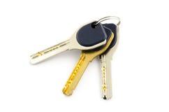 Tre chiavi isolate su bianco Immagine Stock