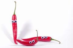 Tre chillis rossi con gli occhi googly Fotografia Stock Libera da Diritti