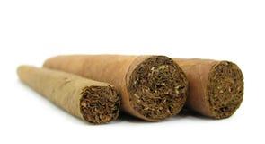 Tre cigarrer Arkivfoton