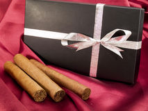 Tre cigarrer med en gåva Fotografering för Bildbyråer