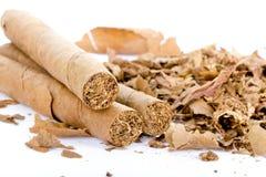 Tre cigarrer och tobak Arkivfoto
