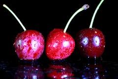 Tre ciliege Fotografie Stock Libere da Diritti