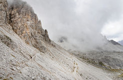 Tre Cime di Lavaredo in a cloudy day Royalty Free Stock Photography