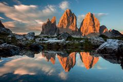 Tre Cime di Lavaredo with reflection in lake at sundown, Dolomit Stock Photo