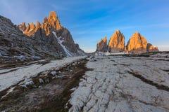 Tre cime di Lavaredo at sunrise, Dolomite Alps, Italy. Tre cime di Lavaredo reflected from a lake, Dolomite Alps, Italy Stock Image