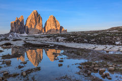 Tre cime di Lavaredo at sunrise, Dolomite Alps, Italy. Tre cime di Lavaredo reflected from a lake, Dolomite Alps, Italy Stock Photos