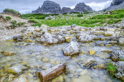 Tre Cime Di Lavaredo valley. Valley in the italy , smooth river Stock Images