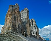 Tre cime of Lavaredo, Dolomites - Italy. The most famous Dolomite peaks in contrast with the blue sky stock photo