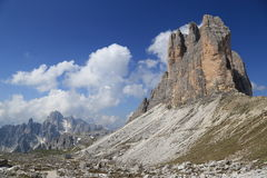 Tre Cime peaks, surrounding mountains and clouds Stock Image