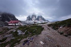 Tre Cime and Rifugio Locatelli at cloudy evening Royalty Free Stock Image