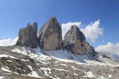 Tre Cime szczyty z chmurami Zdjęcia Stock