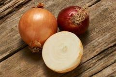 Tre cipolle deliziose Fotografie Stock