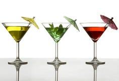 Tre cocktail con l'ombrello Immagine Stock