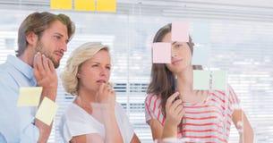 Tre colleghi che sembrano premurosi Fotografia Stock