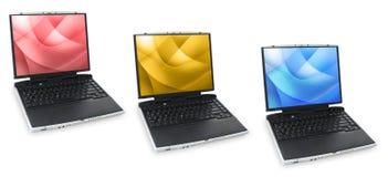 Tre computer portatili colorati Fotografia Stock Libera da Diritti