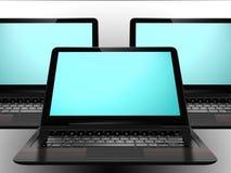 Tre computer portatili con lo schermo blu Immagine Stock Libera da Diritti