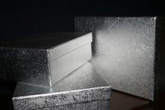 Tre contenitori di regalo d'argento di natale Fotografie Stock