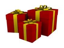 Tre contenitori di regalo rossi con il nastro giallo isolato Immagine Stock