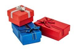 Tre contenitori di regalo su bianco Fotografia Stock