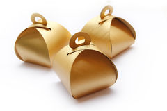 Tre contenitori dorati di pacchetto Fotografia Stock Libera da Diritti