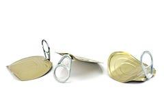 Tre coperchi del barattolo di latta con l'apri Fotografia Stock