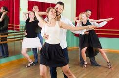 Tre coppie felici che ballano tango Immagine Stock Libera da Diritti