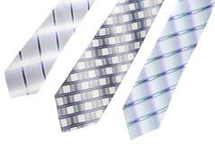 Tre cravatte che pongono sulla priorità bassa bianca Fotografie Stock