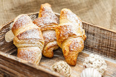 Tre croissant al forno con amore fotografie stock libere da diritti