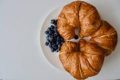 Tre croissant e mirtilli blu Immagine Stock Libera da Diritti