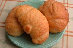 Tre croissant su un piatto Immagine Stock Libera da Diritti